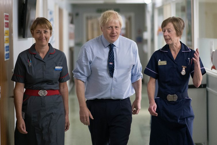 Prime Minister Boris Johnson meets staff during a visit to The Princess Alexandra hospital in Essex,