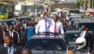 Kenyatta waves triumphantly to crowd