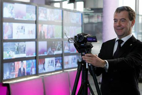 Former President Dmitry Medvedev in the studio at TV Rain playing with a camera.