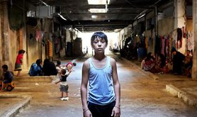 refugee boy in shelter in Lebanon