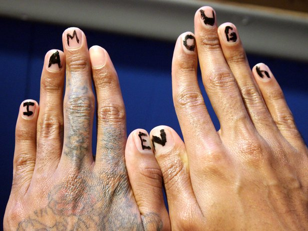 """Hands with """"I am enough"""" written on the nails"""