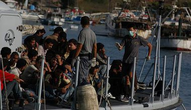 Undocumented migrants arriving by sea at Italian coast