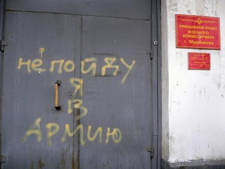 'I won't go to the army' reads this graffiti at the military recruiting office in Murmansk, Russia