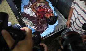 Body of child in Gaza hospital morgue snapped by photographers
