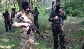 Armed and masked Anti-Kyiv militia on the outskirts of Donetsk.