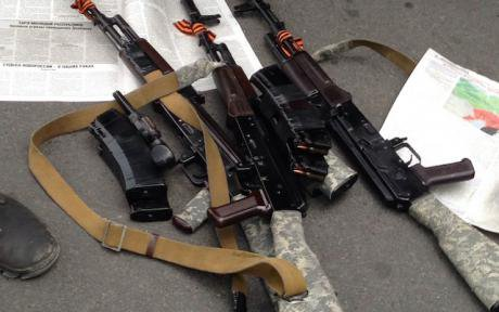 A militia weapons cache. The St. George's ribbon tied on the barrel has become a symbol for the movement.