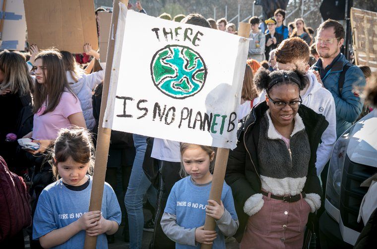 Two children hold a banner against climate change during the climate strike, London, February 2019