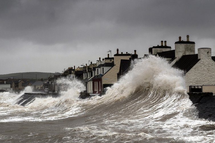 Storm surge, waves crashing into houses on the sea front