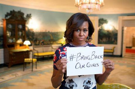 Michelle Obama holds #bringbackourgirls sign