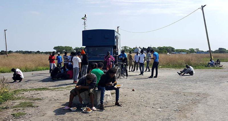 refugee_info_bus_920.jpg