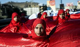 female demonstrators wrapped in red