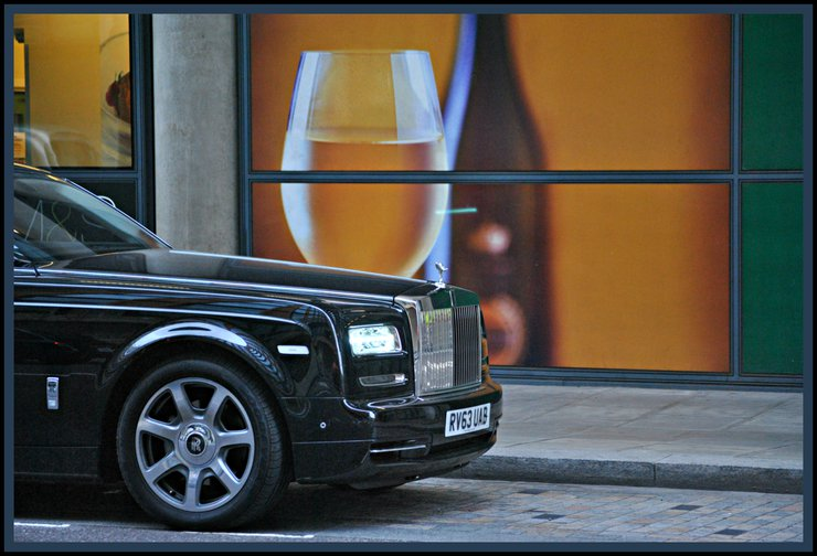 Rolls Royce parked outside wine store, London
