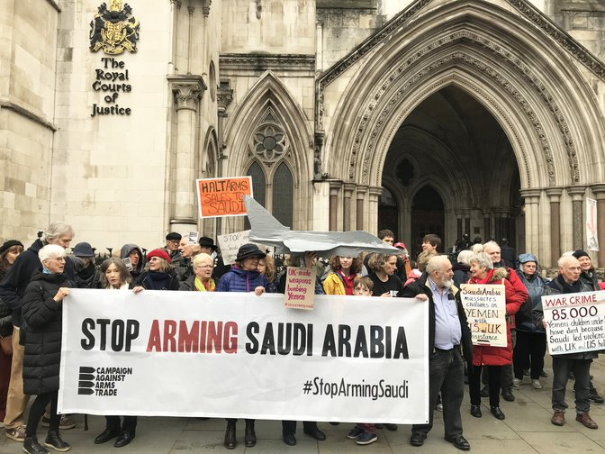 Campaigners outside the Royal Court of Justice during the hearing into UK arms exports to Saudi Arabia