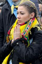 A female Maidan protester prays during a rally in Kyiv