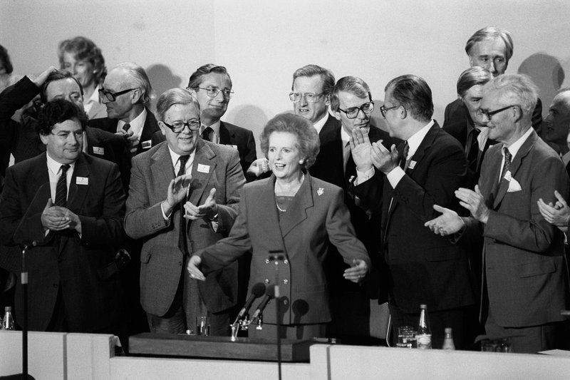 Margaret Thatcher at the Conservative party conference in 1989 flanked by Nigel Lawson, Geoffrey How, Douglas Hurd and other cabinet ministers.