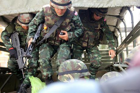 Thai soldiers coming out of truck