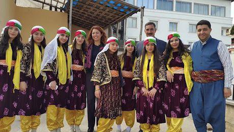 The mayors of Diyarbakir's Sur District, Fatma Şık Barut  and Seyit Narin, with Kurdish  students before their arrest.