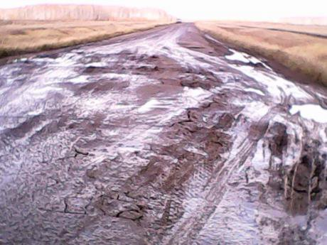 A road in Sargat Region, full of pot holes and cracks